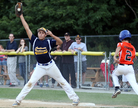 DAVID LE/Staff photo. Andover National first baseman Kyle Wolff stretches to grab a throw that beats Beverly's Ryan Rushton to the bag. 7/21/16.
