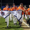 DAVID LE/Staff photo. Beverly players parade the District 15 Championship banner around Harry Ball Field after their 4-2 win over Manchester-Essex on Thursday evening. 7/14/16.