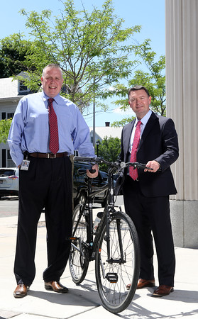 DAVID LE/Staff photo. Patrick Collins, left, an assistant court magistrate at Salem Superior Court, and lawyer Thomas Burke, will be part of a team for the Pan Mass Challenge in tribute to the late Judge Michael Lauranzano, a longtime judge from Beverly who passed away from brain cancer last year. 7/26/16.