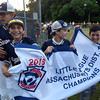 DAVID LE/Staff photo. Swampscott players celebrate their District 16 Championship with a celebratory lap around the field. 7/15/16.