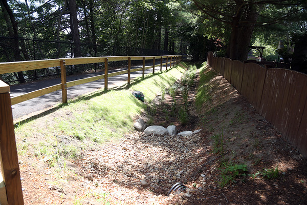 DAVID LE/Staff photo. A way to filter runoff rainwater before being channeled elsewhere is one of the features of the recently renovated Spring Pond Trail. 7/27/16.