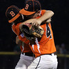 DAVID LE/Staff photo. Beverly starting pitcher and game winner Joe Kotwicki, left, hugs teammate and third baseman Joe Brown following Beverly's 4-2 win over Manchester-Essex in the District 15 Championship. 7/14/16.