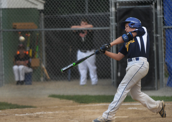 CARL RUSSO/Staff photo. Andover Nationals' Kyle Wolff hits a grand slam in Little League action against Woburn. Andover defeated Woburn 16-6. 7/20/2016