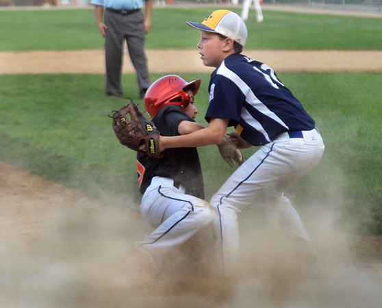 CARL RUSSO/Staff photo. Andover National, Chase Lembo in action at third base. Andover defeated Woburn 16-6 in Little League action. 7/20/2016
