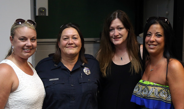 DAVID LE/Staff photo. Peabody Police Department members, Detective Stephanie Lane, retiring police officer Nancy Hart, Lt. Sheila McDaid, and police officer Kristen Marvoulas, following a short ceremony for Hart, a 25 year member of the department. 7/22/16.