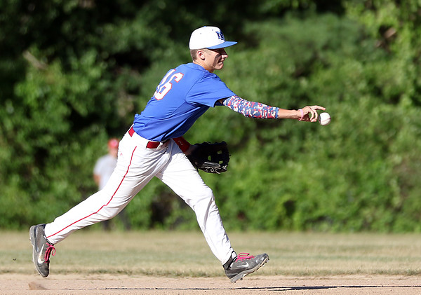 DAVID LE/Staff photo. Middleton-Peabody second baseman Jack Connors flips the ball to first to retire a Newburyport runner. 7/19/16.