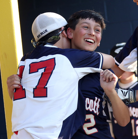 DAVID LE/Staff photo. Swampscott's Connor Correnti (2) gets hugged by teammate Mathew Schroeder following Correnti's 3-run homer to give Swampscott a 5-3 lead over Peabody West in the District 16 Championship. 7/15/16.