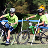 DAVID LE/Staff photo. Two racers in the annual Kids Beverly Gran Prix take a tight turn while racing around Beverly Common prior to the start of the Elite Men's and Women's Races on Wednesday. 7/29/16.