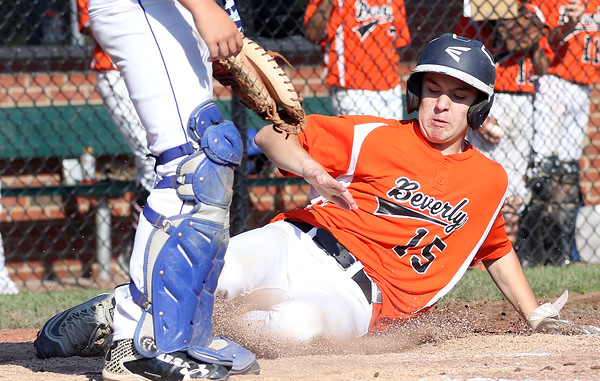 DAVID LE/Staff photo. Beverly's Joey Loreti slides safely home to score one of Beverly's 19 runs against Fairhaven/Acushnet on Friday afternoon. 7/29/16.