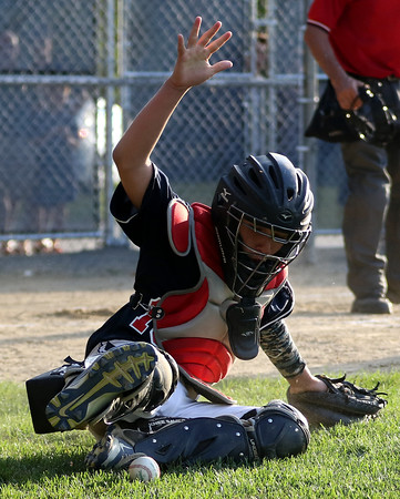 DAVID LE/Staff photo. Peabody West catcher Chris Faraca makes a sliding stop of a baseball in foul territory. 7/15/16.