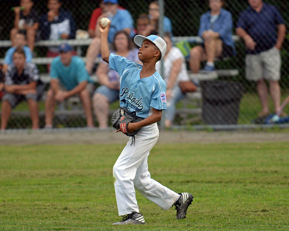 RYAN HUTTON/ Staff photo<br /> Peabody's Eli Batista throws the ball back in from the outfield during the top of the third inning of Saturday night's Section 4 Little League championship against Gloucester at Wyoma Field.