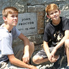 HADLEY GREEN/Staff photo<br /> Liam and Dylan Staunton, descendants of John Proctor, pose in front of his plaque at the new Proctor's Ledge memorial. John Proctor was one of the 19 innocent people hanged in 1692 for the supposed crime of witchcraft. 7/18/17