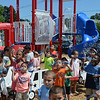 RYAN HUTTON/ Staff photo<br /> Children blow bubbles to celebrate the opening of the new playground at the South Memorial School in Peabody on Wednesday which is named in honor of Ella Jade O'Donnell, a local 10-year-old who died of brain cancer last year.