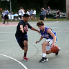 HADLEY GREEN/Staff photo<br /> Wes Rockett, 16, of Marblehead dribbles while Alex Sanchez, 19, of Salem plays defense at the 3 on 3 basketball tournament to raise money for Sophia Smith. 8/01/17