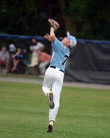 RYAN HUTTON/ Staff photo<br /> Peabody's Danny Barrett looks to snag a fly ball for the out  during the top of the first inning of Saturday night's  Section 4 Little League championship at Wyoma Field.