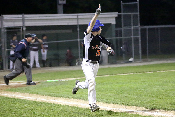HADLEY GREEN/ Staff photo<br /> Beverly's Ian Visnick (15) hits a home run at the Beverly v. Gloucester District Finals Little League game. 7/14/17
