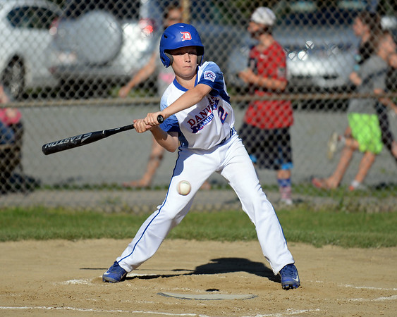 RYAN HUTTON/ Staff photo<br /> Danvers' Will McEnaney checks his swing as a low pitch during the bottom of the first inning of Wednesday's game against Gloucester at Boudreau Field in Gloucester.