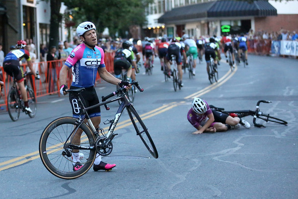 HADLEY GREEN/Staff photo<br /> Sam Rosenholtz picks up his bike after losing control of his bike as he crossed the finish line during the Men State Championship race at the Grand Prix of Beverly. 7/26/17