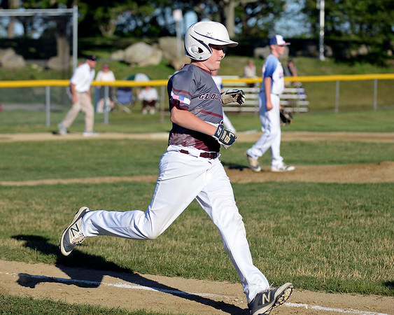 RYAN HUTTON/ Staff photo<br /> Gloucester's Max Vieira sprints to first during the top of the fourth inning of Wednesday's game against Danvers at Boudreau Field in Gloucester.