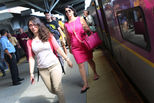 HADLEY GREEN/Staff photo<br /> Nancy Braase of Manchester disembarks the commuter rail at North Station after taking the Newburyport Rockport shuttle bus to the Salem MBTA Station. 7/18/17