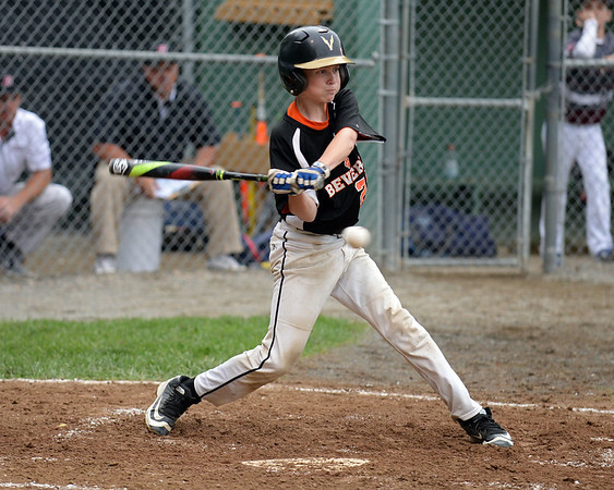 RYAN HUTTON/ Staff photo<br /> Beverly's Casey Bellew swings away at a pitch during the bottom of the first inning of Thursday's District 15 Little League Final game against Gloucester at Harry Ball Field in Beverly on Thursday.
