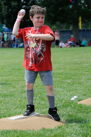 TIM JEAN/Staff photo<br /> Tyler Moody, 7, of Danvers, throws a pitch in the Red Sox Mobile unit game area, during the 3rd Annual Field Day and Scoop-Ah-Bowl party and Family Festival at Plains Park in Danvers. 7/1/17