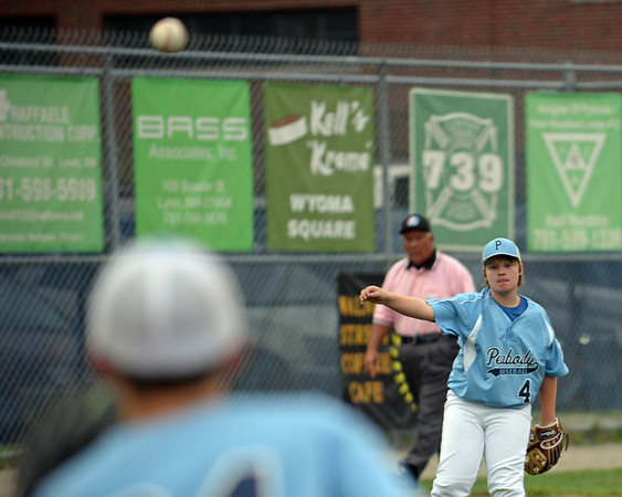 RYAN HUTTON/ Staff photo<br /> Peabody's Ryan Brunet fires the ball from third to Justin Powers at first base during the top of the third inning of Saturday night's Section 4 Little League championship against Gloucester at Wyoma Field.