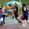HADLEY GREEN/Staff photo<br /> Alex Sanchez, 19, of Salem, goes for the basket while guarded by the opposing team during the 3 on 3 basketball game held in Marblehead to raise money for Sophia Smith. 8/01/17
