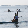 HADLEY GREEN/ Staff photo<br /> A woman waves to people on the shore before beginning her paddleboard race at the Paddle for Plummer annual fundraiser for the Plummer Youth Promise in Salem, Massachusetts. 7/08/17