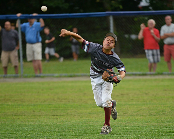 RYAN HUTTON/ Staff photo<br /> Gloucester's Emerson Marshall fires the ball in from right field during the bottom of the first inning of Saturday night's Section 4 Little League championship against Peabody at Wyoma Field.
