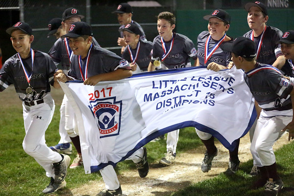 HADLEY GREEN/ Staff photo<br /> Gloucester players run with the title banner around the baseball field after winning against Beverly in the District Finals. 7/14/17