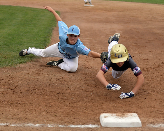RYAN HUTTON/ Staff photo<br /> Peabody's Justin Powers makes a double play by tagging out Gloucester's Daniel Hafey while he tries to get back to first after Powers caught a fly ball for the first out during the top of the second inning of Saturday night's  Section 4 Little League championship at Wyoma Field.