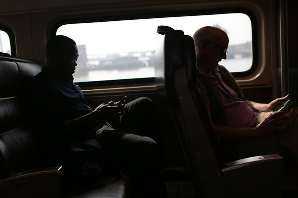 HADLEY GREEN/Staff photo<br /> People ride the MBTA commuter rail train to North Station.7/18/17