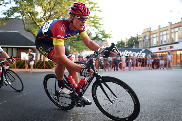HADLEY GREEN/Staff photo<br /> A cyclist in the Men's State Championship race turns onto Cabot Street at the Grand Prix of Beverly. 7/26/17