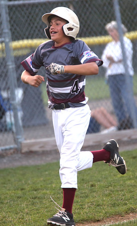 HADLEY GREEN/ Staff photo<br /> Gloucester's Emerson Marshall (4) celebrates as he approaches home plate at the Hamilton-Wenham v. Gloucester Little League tournament game at the Harry Ball Field in Beverly. 7/11/17