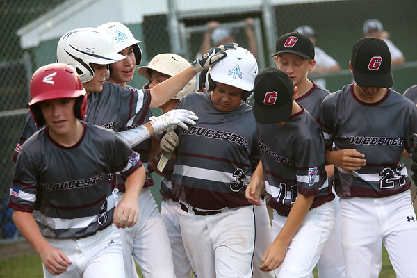 HADLEY GREEN/ Staff photo<br /> Gloucester players congratulate their teammate Zach Morris (3) after scoring at the Hamilton-Wenham v. Gloucester Little League tournament game at the Harry Ball Field in Beverly. 7/11/17