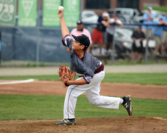 RYAN HUTTON/ Staff photo<br /> Gloucester's Zach Morris fires one in during the bottom of the first inning of Saturday night's Section 4 Little League championship against Peabody at Wyoma Field.