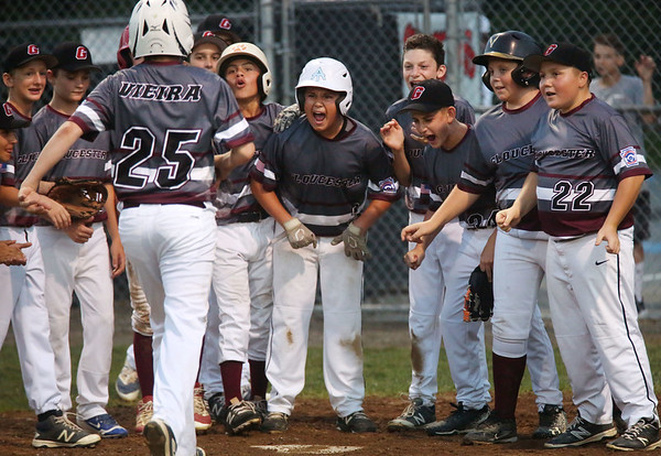 HADLEY GREEN/ Staff photo<br /> Gloucester players congratulate Max Viera (25) after scoring at the Hamilton-Wenham v. Gloucester Little League tournament game at the Harry Ball Field in Beverly. 7/11/17