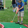 TIM JEAN/Staff photo<br /> William Shaw, 5, of Beverly, putts on the mini golf course during the 3rd Annual Field Day and Scoop-Ah-Bowl party and Family Festival at Plains Park in Danvers. 7/1/17
