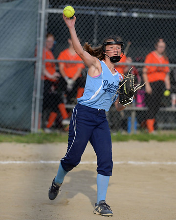 RYAN HUTTON/ Staff photo<br /> Peabody pitcher Abigail Bettencourt hurls the ball to first to try and make the out after fielding a bunt in the top of the third inning of Thursday's game against Woburn at the Lt. Ross Park.