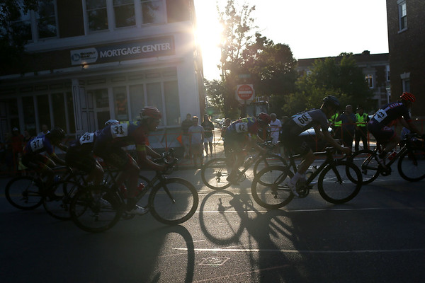 HADLEY GREEN/Staff photo<br /> Cyclists in the Men's State Championship competition race through Beverly as the sun goes down. 7/26/17