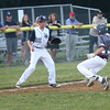 HADLEY GREEN/ Staff photo<br /> Hamilton-Wenham's Zack Webber (22) prepares to catch the ball while Gloucester's Tommy Elliott (12) runs to third base at the Hamilton-Wenham v. Gloucester Little League tournament game at the Harry Ball Field in Beverly. 7/11/17