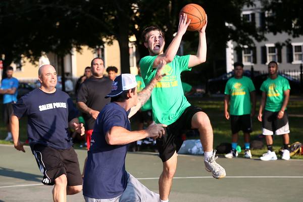 HADLEY GREEN/Staff photo<br /> Members of the Salem Police and Fire Departments and Salem Boys and Girls Club faced off on the Salem Common basketball courts at the Salem National Night Out. 8/01/17