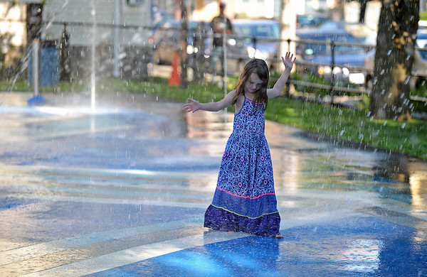 RYAN HUTTON/ Staff photo<br /> Kate Barricelli, 7, enjoys the splash pad during the grand re-opening of the Mary Jane Lee Park in the Point in Salem on Wednesday.