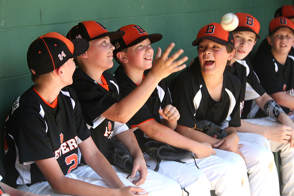 HADLEY GREEN/ Staff photo<br /> Beverly Williamsport players celebrate in the dugout after winning their game against Hamilton-Wenham. 7/08/17
