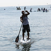 HADLEY GREEN/ Staff photo<br /> Thamas Buday comes in first at Paddle for Plummer's annual paddleboard race on Winter Island. 7/08/17