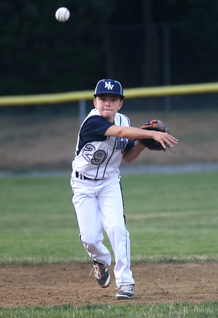 HADLEY GREEN/ Staff photo<br /> Hamilton-Wenham's short stop Will Cooke (29) throws the ball at the Hamilton-Wenham v. Gloucester Little League tournament game at the Harry Ball Field in Beverly. 7/11/17