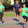 HADLEY GREEN/Staff photo<br /> Members of the Salem Police and Fire Department and Salem Boys and Girls Club faced off on the Salem Common basketball courts at the Salem National Night Out. 8/01/17