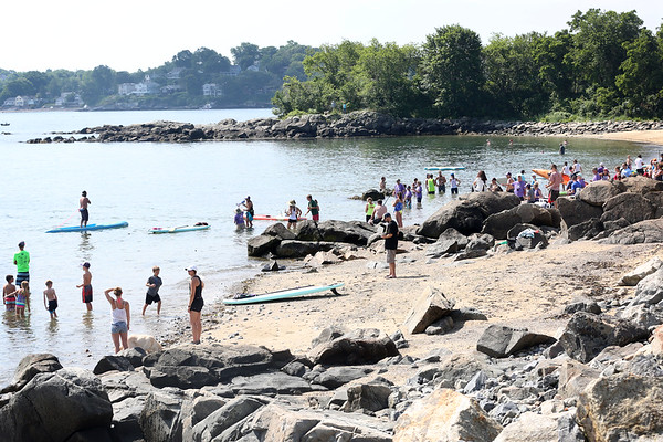 HADLEY GREEN/ Staff photo<br /> Volunteers and spectators swarmed the beach of Winter Island at the Paddle for Plummer annual fundraiser for the Plummer Youth Promise in Salem, Massachusetts. 7/08/17