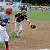 RYAN HUTTON/ Staff photo<br /> Beverly's Ian Visnick runs to try to make the play at first during the top of the first inning of Thursday's District 15 Little League Final game against Gloucester at Harry Ball Field in Beverly on Thursday.